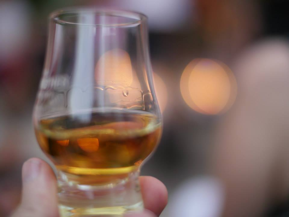 whisky-glass-with-female-hand-photo-credit-travis-stevens