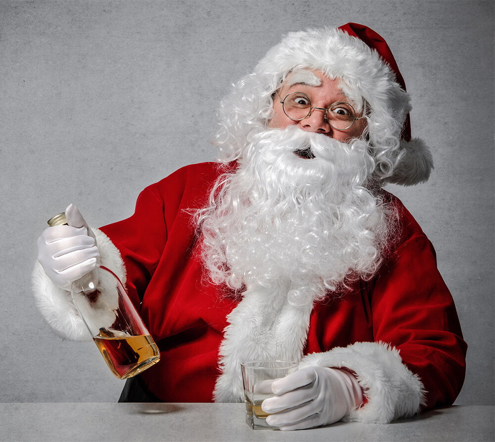 Santa with whisky bottle and glass